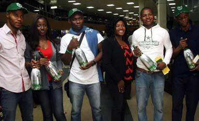 WEMBLEY BOUND...Five Champions League fans on the sponsorship of Heineken on Thursday night at the departure hall of Murtala Mohammed International airport in Lagos for the final match of the UEFA Champions League in Wembley, London.