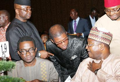 R-L; Group Managing Director, Nigerian National Petroleum Corporation, NNPC, Mr.Andrew Yakubu; President South South, South-East Professional, Mr. Emeka Ukwu-Oji; Chairman, Petroleum Technology Association of Nigeria, PETAN Mr. Emeka Ene; Manager Public Affairs, NNPC, Mr. Ejikeme, during the NNPC/PETAN Dinner and Award Night in honour of the Nigerian contingent to the Offshore Technology Conference, OTC 2013 held in Houston, Texas USA.
