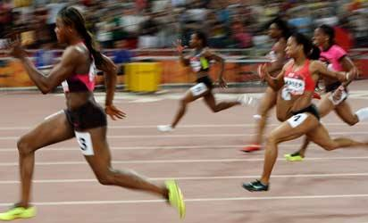 Blessing Okagbare of Nigeria (L) leads on her way to winning the Women's 100m final at the IAAF World Challenge held at the National Olympic Stadium or 'Birds Nest' in Beijing on May 21, 2013.  Okagbare won with a time of 11.04 seconds.     AFP PHOTO