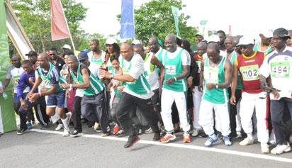 PIC. 5. GOV. ADAMS OSHIOMHOLE (3RD R) OF EDO AND OTHERS TAKING  OFF DURING THE VIP RACE AT THE OKPEKPE INTERNATIONAL 10KM ROAD  RACE IN AUCHI, EDO, ON SATURDAY (4/5/13).