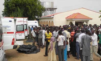 TEARS FOR SLAIN POLICEMEN—Ambulances bringing the remains of the slain Police officers to Dalhatu Specialist Hospital Morgue in Lafia, Nasarawa State, yesterday. Photo: NAN.