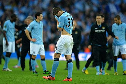 Manchester City's Serbian defender Matija Nastasic (C) reacts at the end of the English FA Cup final football match between Manchester City and Wigan Athletic at Wembley Stadium in London on May 11, 2013.Photo: AFP