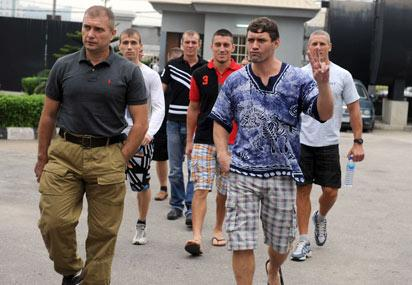 TRIAL—Russian sailors arrive at the Federal High Court in Lagos yesterday, for their trial over alleged illegal importation of arms. AFP photo.