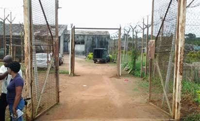 The broken gate of Olokuta Medium Prison, Akure, Ondo State