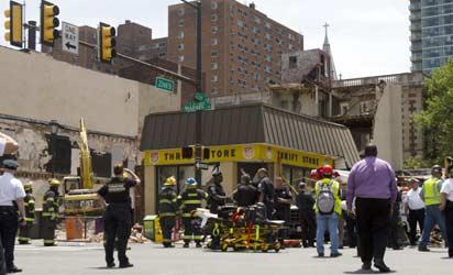 PHILADELPHIA, PA - JUNE 5: Rescue workers search for victims and clear debris from a building that collapsed in an apparent accident at a demolition site, at 22nd and Market Streets, June 5, 2013 in Philadelphia, Pennsylvania. The building being demolished landed on top of a Salvation Army Thrift Store, destroying most of it and reportedly trapping and injuring over a dozen people.  Images/AFP