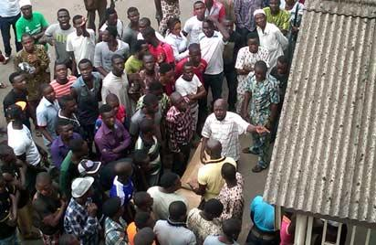 *The angry mob, Inset: Gov Babatunde Fashola