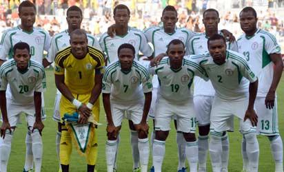Nigeria's footballers pose for the official picture before the start of the FIFA Confederations Cup Brazil 2013 Group B football match against Tahiti, at the Mineirao Stadium in Belo Horizonte on June 17, 2013. (Standing L-R) Midfielder John Obi Mikel, defender Uwa Echijile, defender Efe Ambrose, defender Kenneth Omeruo, forward Anthony Ujah and midfielder Fegor Ogude. (First row, L-R) Forward Nnamdi Oduamadi, goalkeeper Vincent Enyeama, forward Ahmed Musa, midfielder Sunday Mba and defender Godfrey Oboabona.   AFP PHOTO