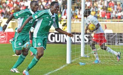 KENYA, Nairobi : Nigeria's Ahmed Musa (R) and Sunday Mba (L) celebrate after Musa scored to make it 1-0 during their 2014 World Cup Qualifying match against Kenya at Kasarani football stadium on June 5, 2013. AFP PHOTO
