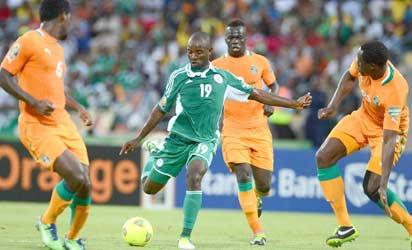 FIRING POWER... Super Eagles attacking midfielder, Sunday Mba puts Ivorian players in the firing range as he scored a brace in yesterday's CAF African Nations Championship qualifier at the Ahmadu Bello Stadium Kaduna.
