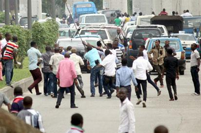 Rival youth supporters clash in PortHarcourt yesterday