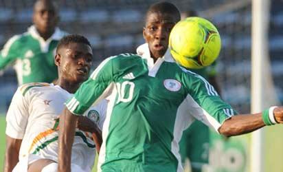 GOLDEN EAGLETS' Kelechi Ihenacho protects the ball from an opponent during a FIFA U-17 World Cup qualifier in Calabar