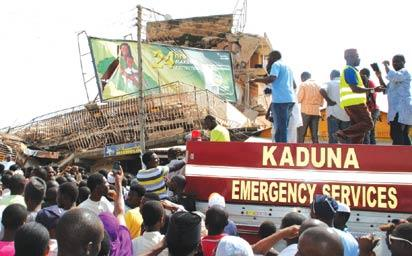 *Rescue operation at the scene of the Kaduna building collapse. INSET: Master Kehinde on his hospital bed