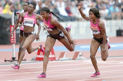 Blessing Okagbare of Nigeria (2-r) stretches to cross the line in the womens 100 metres event during the London Anniversary Games International Association of Athletics Federations (IAAF) Diamond League International Athletics Championships at the Olympic Stadium in London yesterday.