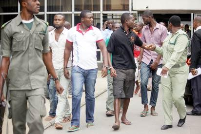 Suspects in the murder of The UNIPORT FOUR at the Rivers State High Court,Port Harcourt, yesterday. Photo: Nwankpa Chijioke