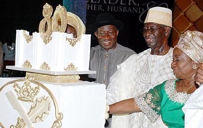 Tony 1 President Goodluck Jonathan left Chief Tony Anenih  and his Wife  Dame Patricia  Anenih Cutting Chief Tony Anenihs 80th Birthday