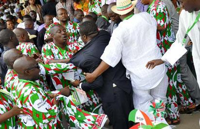 *Fight at PDP Special National Convention:  Aids of Andy uba and Tony Nwoye clashed at 2013 PDP Special National Convention.  Photo by Gbemiga Olamikan.