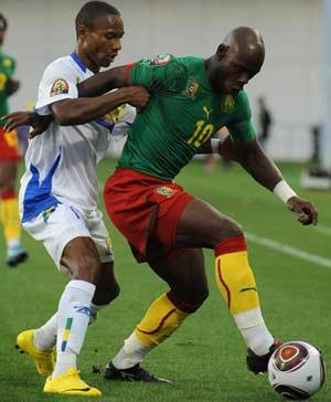TUSSLE: Arsene Copa of Gabon and Achille Emana of Cameroon in a contest for the ball