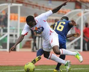 Oghogho Oduokpe of Rangers is tackled by Odili Iyasele of Bayelsa United during their 2013 Glo Nigeria Premier League match at Nnamdi Azikiwe Stadium, Enugu