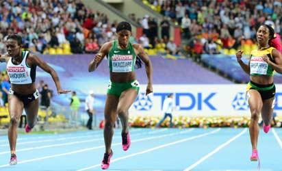 Dashing to the finish...(L-R) Ivory Coast's Murielle Ahoure, Nigeria's Blessing Okagbare and Jamaica's Shelly-Ann Fraser-Pryce during the women's 200 metres final at the 2013 IAAF World Championships at the Luzhniki stadium in Moscow yesterday.