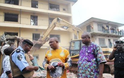Gov Obi supervising the demolition...