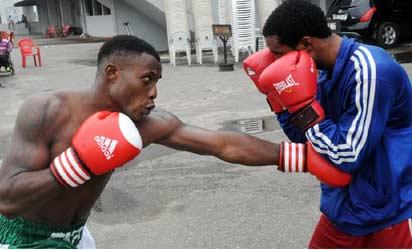 Isaac Ekpo (L) Super Middle Weight Boxing Champion with his Coach, Seidu Kalifa, in training  at the National Stadium In Lagos recently.