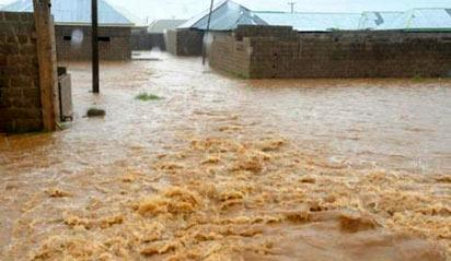 *Community sacked by flood in Bauchi. INSET: Motorcycles and tricycles wading through a flooded road