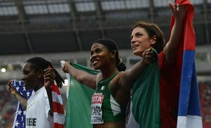 (L-R) Winner US Brittney Reese, silver medallist Nigeria's Blessing Okagbare and bronze Serbia's Ivana Spanovic pose after the women's long jump final at the 2013 IAAF World Championships at the Luzhniki stadium in Moscow on August 11, 2013.  AFP PHOTO