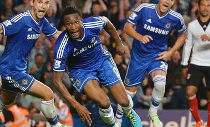 Delightful... Chelsea's Nigerian midfielder John Mikel Obi celebrate with team-mates