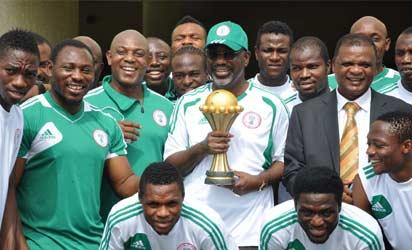 Gov. Liyel Imoke of Cross River (m) flanked by 1st  Vice President, NFF, Chief Mike Umeh (r) and Chief Coach of the  Super Eagles, Mr Stephen Keshi (l), hen The Team Presented The  2012 Afcon Trophy They Won In South Africa To The Governor In Calabar On Wednesday