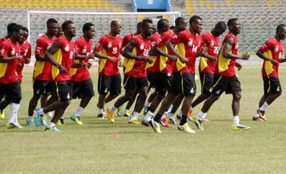 *Black Stars' - Ghana's national football team players jog during a training session on October 9, 2013 in Accra. Ghana will play Egypt on October 15 in a qualification match for the 2014 Football World Cup.   AFP PHOTO