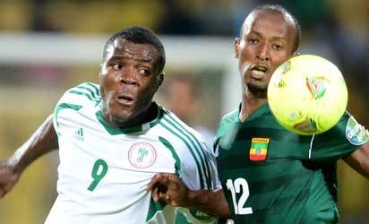 BATTLE......Emmanuel Emenike (left) of Nigeria battles  for the ball with Ethiopia's  Biyadiglign Elyas  during a match at AFCON 2013