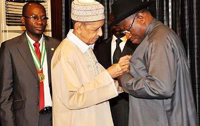 *DECORATION—From left: Dr. Osahon Enabulele, Nigerian Medical Association, NMA, President; Professor Umaru Shehu, Chairman, NMA BoT; and President Goodluck Jonathan, at the decoration of President Jonathan with the nma insignia, during a visit to the Presidential Villa, Abuja. Photo: State House.