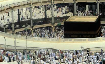 Muslim pilgrims leave after performing the Friday prayer at Mecca's Grand Mosque, on October 11, 2013 as hundreds of thousands of Muslims have poured into the holy city of Mecca for the annual hajj pilgrimage. The hajj is one of the five pillars of Islam and is mandatory once in a lifetime for all Muslims provided they are physically fit and financially capable.  AFP PHOTO