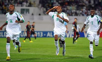 AL AIN, UNITED ARAB EMIRATES -  Nigerian players  celebrate the fourth goal during the FIFA U17 World Cup group F match between Mexico and Nigeria at Khalifa Bin Zayed Stadium on October 19, 2013 in Al Ain, United Arab Emirates. (Photo by FIFA/FIFA)