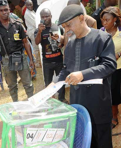APC GOVERNORSHIP CANDIDATE, SEN. CHRIS NGIGE CASTING HIS VOTE DURING ANAMBRA  GOVERNORSHIP ELECTION AT ALOR WARD OF IDEMILI SOUTH LOCAL GOVERNMENT AREA OF ANAMBRA STATE ON SATURDAY (16/11/13).