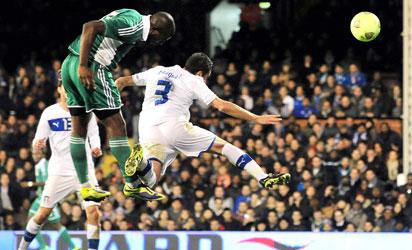 UNITED KINGDOM, London : Nigeria's striker Bright Dike (L) scores the equalising goal during the International friendly football match between Italy and Nigeria at Craven Cottage in London on November 18, 2013. AFP PHOTO