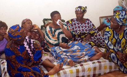 TEARS FOR IYAYI—Relations and sympathisers console Mrs Grace Iyayi (4th L), widow of former president of ASUU, Late Prof. Festus Iyayi at Ekosodin in Benin City. Photo: Barnabas Uzosike.