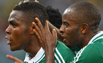 IMPERIAL ... Emenike is congratulated by team mates after scoring.
