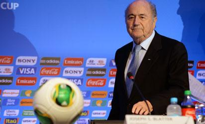 BRAZIL, Costa do Sauipe : Fifa president Joseph Blatter gestures during a press conference in Costa do Sauipe, state of Bahia, Brazil on December 3, 2013. The 2014 FIFA World Cup Brazil final draw will take place December 6. AFP PHOTO