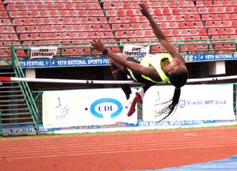 FANTASTIC ... Rivers State athlete, Miss Esiekpe Young, flying over the bar during High Jump event at the 18th National Sports Festival held Thursday at National Stadium, Surulere, Lagos. Photo by: Kehinde Gbadamosi
