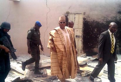 TERROR ATTACK—Gov. Kashim Shettima of Borno State, yesterday, inspecting a burnt mosque and some houses after Sunday's attack by a terror group in Kawuri, Konduga Lga of the state, where about 85 persons died and 300 houses destroyed. Below: Governor Shettima visits some victims of the attack in the hospital. Photos: NAN & Inusa Ndahi.