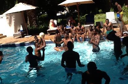 *COOLING OFF  ••• Super Eagles' players cooling off in the pool of their hotel on Sunday morning