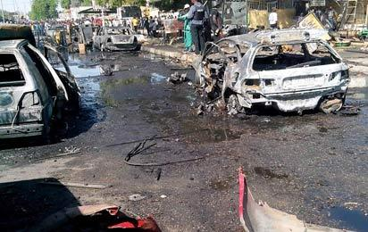 Scene of  the bomb blast at the post office area of Maiduguri in Borno State, yesterday. 17 people died in the blast. Photos: NAN..