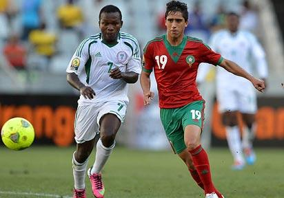 *Abdelkbir El Ouadi of Morocco evades challenge from Christantus Ejike of Nigeria during the 2014 CAF African Nations Championships Quarterfinal football match between Morocco and Nigeria at Cape Town Stadium, Cape Town on 25 January 2014