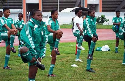 *GETTING READY . . .  Members of the female national U-17 soccer team, the Flamingoes shaping up during one of their training sessions