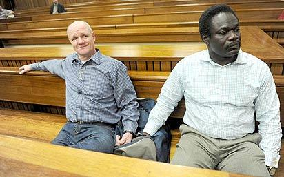 *CONVICTS . . . Andre Gouws (L) and his co-accused, former Nigerian Olympic athlete Ambrose Monye in the North Gauteng High Court, South Africa on Monday when their judgment was handed down to them