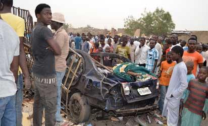 People look at the wreckage of a car, yesterday, after two explosions killed over 35 people in a crowded neighbourhood in Maiduguri, Borno State, weekend. Photo: AFP.