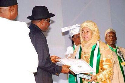 Jonathan hands to late Gen Sani Abacha's widow, Mariam Abacha. Source: Goodluck Jonathan FB wall