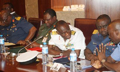 Chief of Defence Staff, Air Chief Marshal Alex Bade (l); Inspector General of Police, Alhaji Mohammed Abubakar (r) and other Service Chiefs during the day-long security meeting chaired by President Goodluck Jonathan at the State House, Abuja. Photo by Abayomi Adeshida 02/05/2014