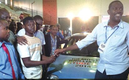 *Ag. President, Association of Tutorial School Operators, ATSO, Mr. Sodunke Michael, handing over Nissan Starlet car key to the winner, Caleb Uzuegbunam